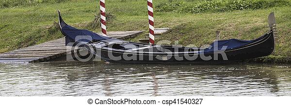 gondola on river in winter - csp41540327