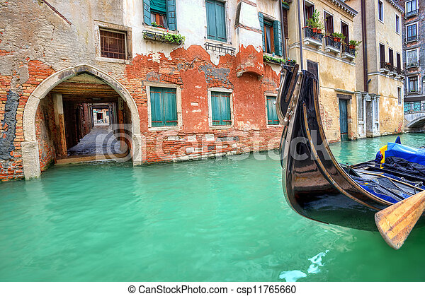 Gondola on small canal in Venice, Italy. - csp11765660