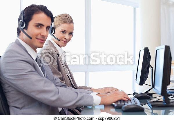 Good looking operators using a computer - csp7986251