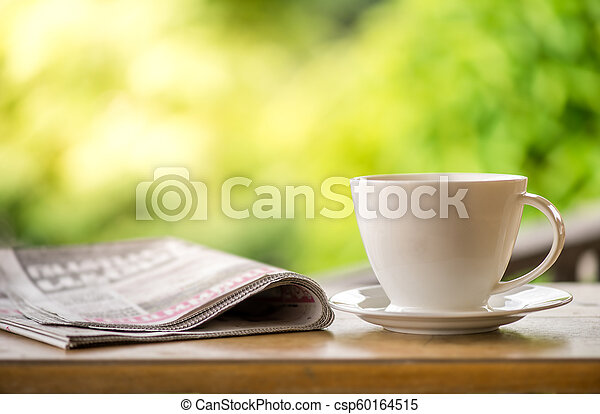 Good Morning Coffee Cup With News Paper On Nature Green Background