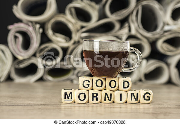 Good morning with coffee and newspaper - csp49076328