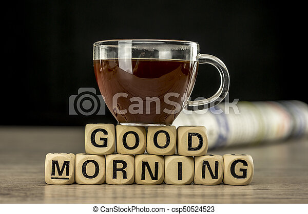 Good morning with coffee and newspaper - csp50524523