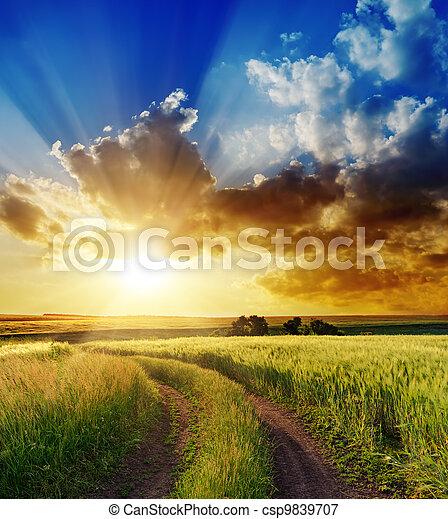 good sunset over rural road - csp9839707