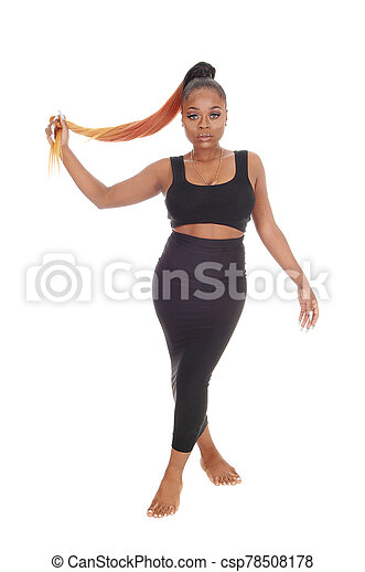 Gorgeous African woman standing in a black dress - csp78508178