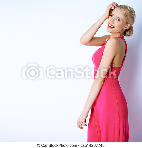 Gorgeous blond sexy woman posing in pink dress - csp14207745