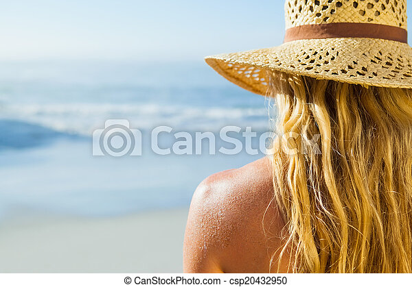 Gorgeous blonde in sunhat on the beach - csp20432950