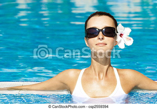 gorgeous brunette in pool - csp2559394