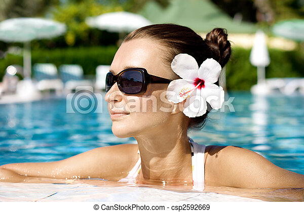 gorgeous brunette in pool - csp2592669