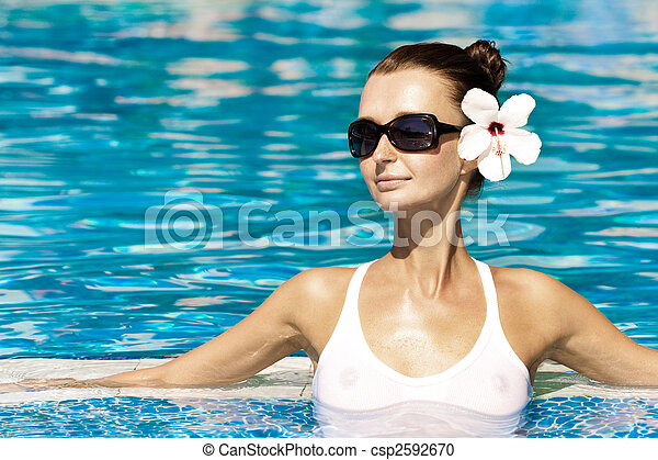 gorgeous brunette in pool - csp2592670