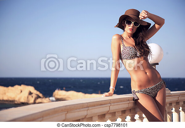 Gorgeous brunette on vacation day - csp7798101