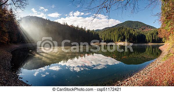gorgeous foggy morning on the mountain lake - csp51172421