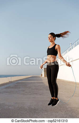 Gorgeous young happy sports woman make sport exercises - csp52161310