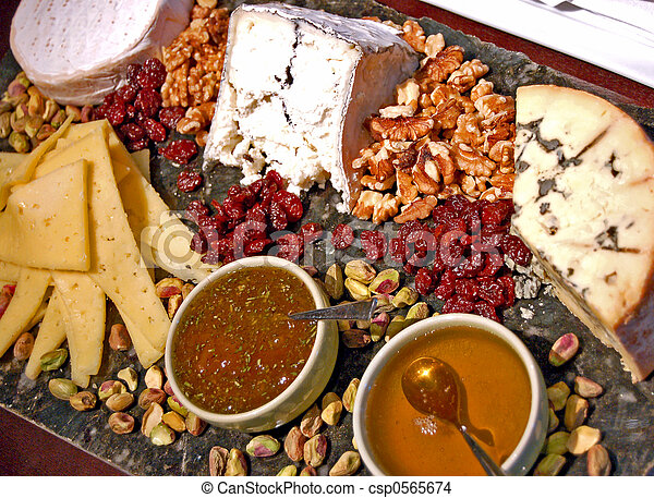 cheese tray on display at a wine shop & Gourmet cheese tray. Cheese tray on display at a wine shop.