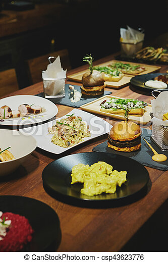 Gourmet food on a wooden table. - csp43623776