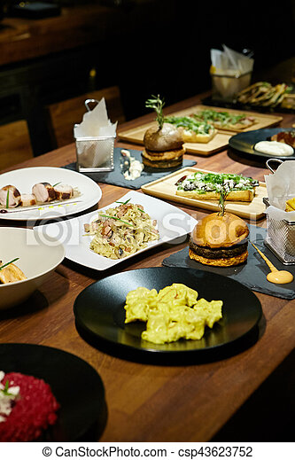 Gourmet food on a wooden table. - csp43623752