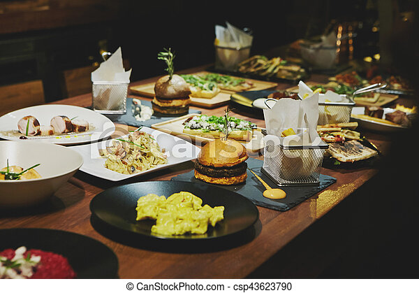 Gourmet food on a wooden table. - csp43623790