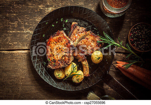 Gourmet meal of marinated pork cutlets - csp27055696