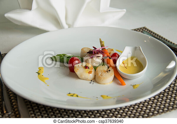 gourmet seared scallops with garnishes. - csp37639340