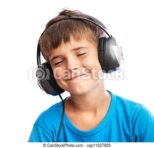 El chico está disfrutando de la música - csp11527925