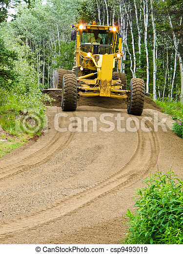 Grader resurfacing narrow rural road - csp9493019