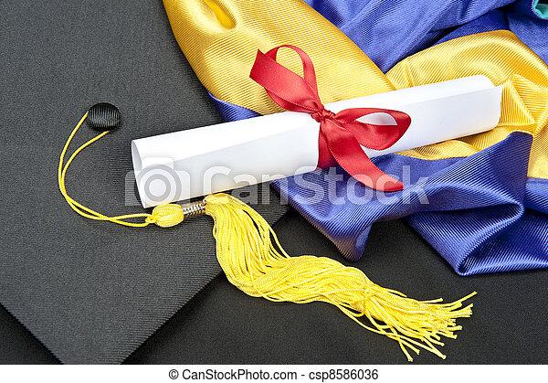 Graduation cap and diploma - csp8586036