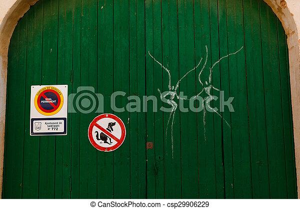 Graffiti on a gate in Santanyi, Mallorca - csp29906229