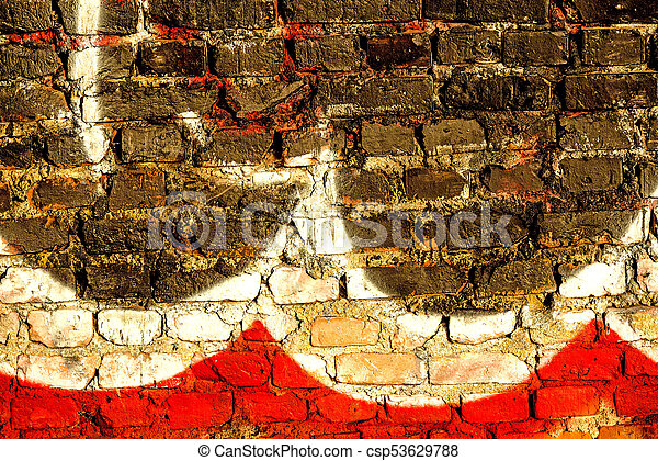 graffitti on an old brick wall