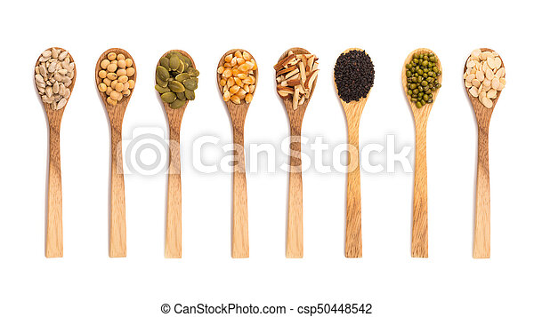 grains seeds in wooden spoon isolated on white background - csp50448542