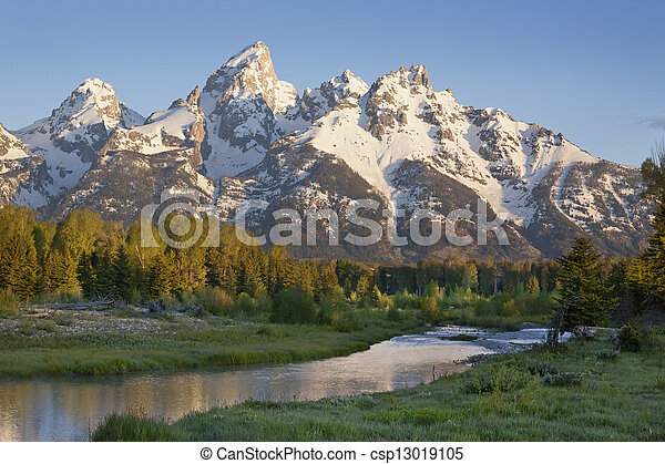 Grand Teton mountains with stream in morning light - csp13019105