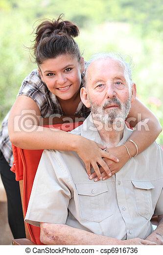 Grandad or grandpa with smiling happy grandaughter - csp6916736