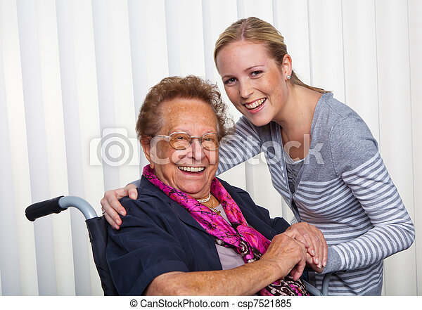 grandchild visits grandmother in a wheelchair - csp7521885