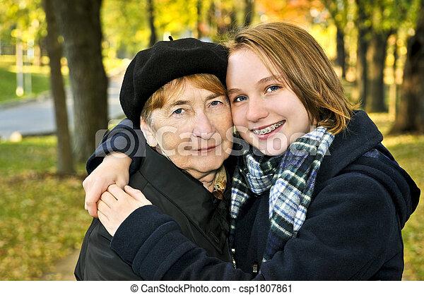 Granddaughter hugging grandmother - csp1807861