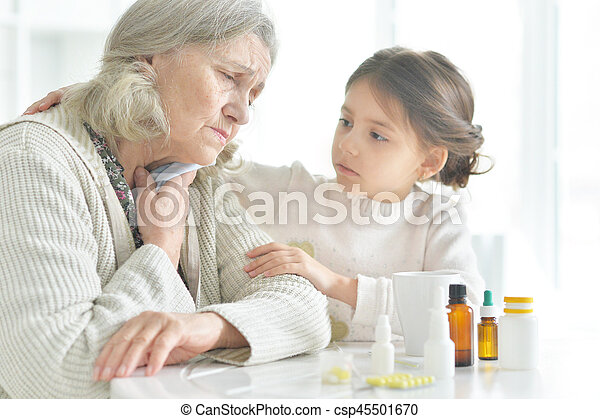 Granddaughter takes care of a sick grandmother - csp45501670