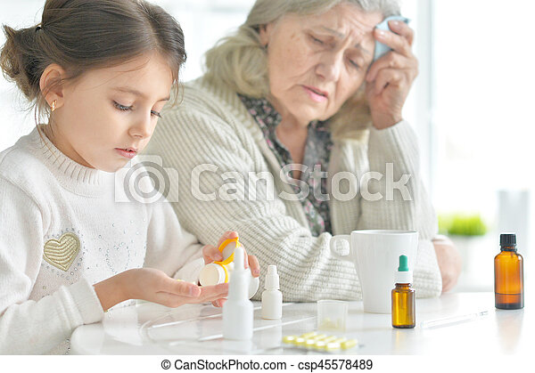 Granddaughter takes care of a sick grandmother - csp45578489