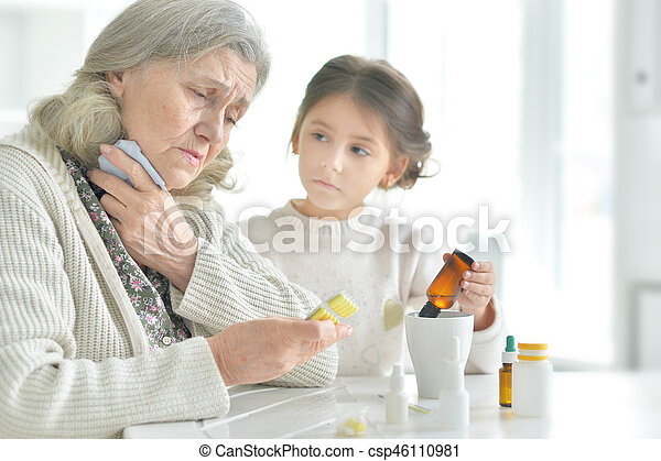 Granddaughter takes care of a sick grandmother - csp46110981
