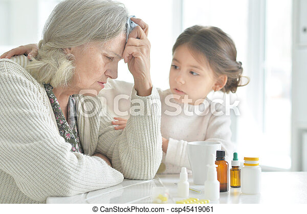 Granddaughter takes care of a sick grandmother - csp45419061