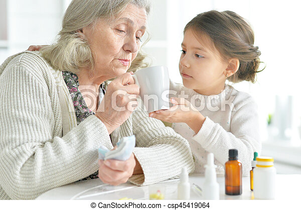 Granddaughter takes care of a sick grandmother - csp45419064