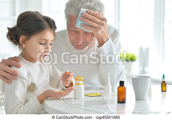 Granddaughter takes care of a sick grandfather - csp45501665