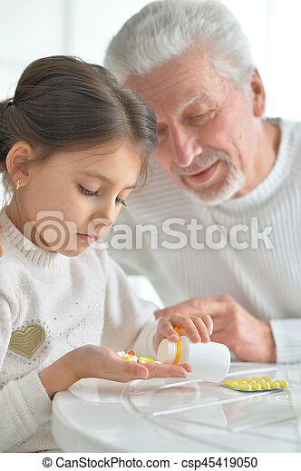 Granddaughter takes care of a sick grandfather - csp45419050