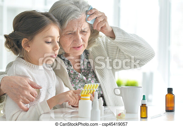 Granddaughter takes care of a sick grandmother - csp45419057