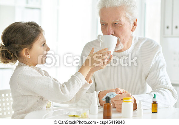 Granddaughter takes care of a sick grandfather - csp45419048