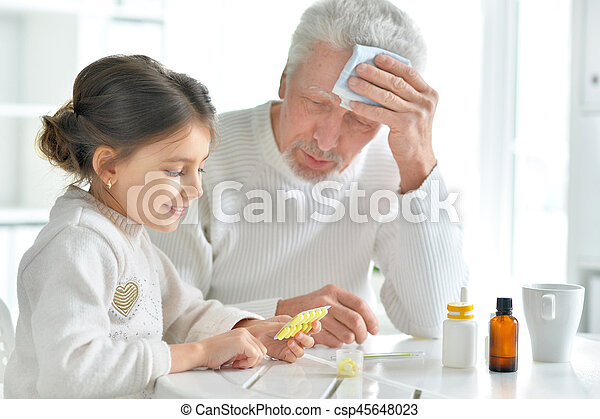 Granddaughter takes care of a sick grandfather - csp45648023