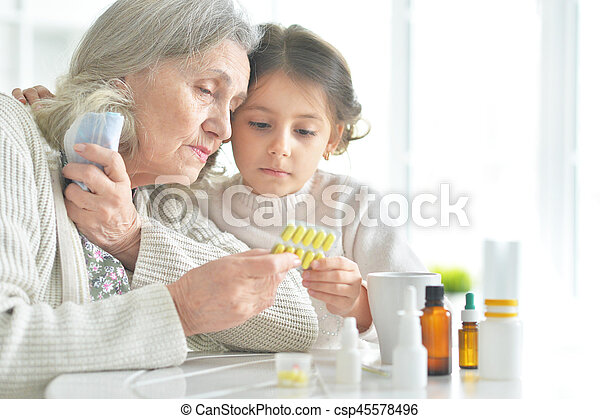 Granddaughter takes care of a sick grandmother - csp45578496