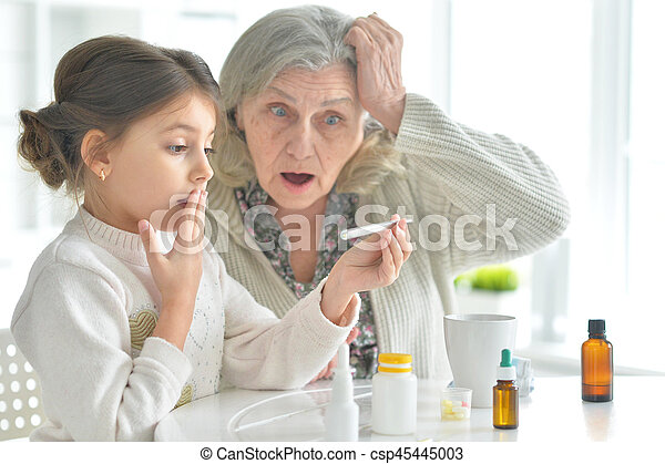 Granddaughter takes care of a sick grandmother - csp45445003