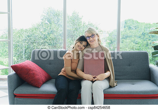 Granddaughter takes care of grandmother - csp84254658