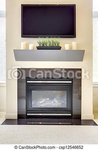 Nueva chimenea moderna con TV grande. - csp12546652