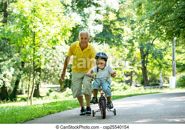 grandfather and child have fun  in park - csp25540154