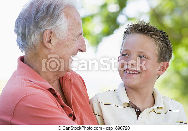 Grandfather and grandson smiling outdoors. - csp1890720
