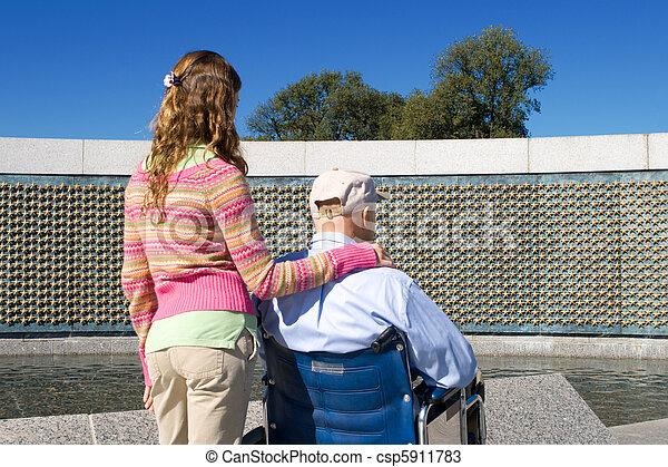 Grandfather Granddaughter Wheelchair WWII Memorial - csp5911783