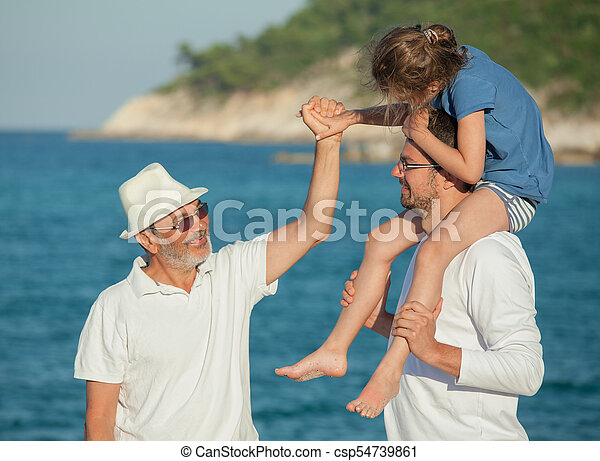 Grandfather Sea Beach Hands Father Daughter Shoulders - csp54739861